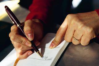 Woman hands checking calendar