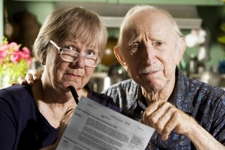 Older couple with document